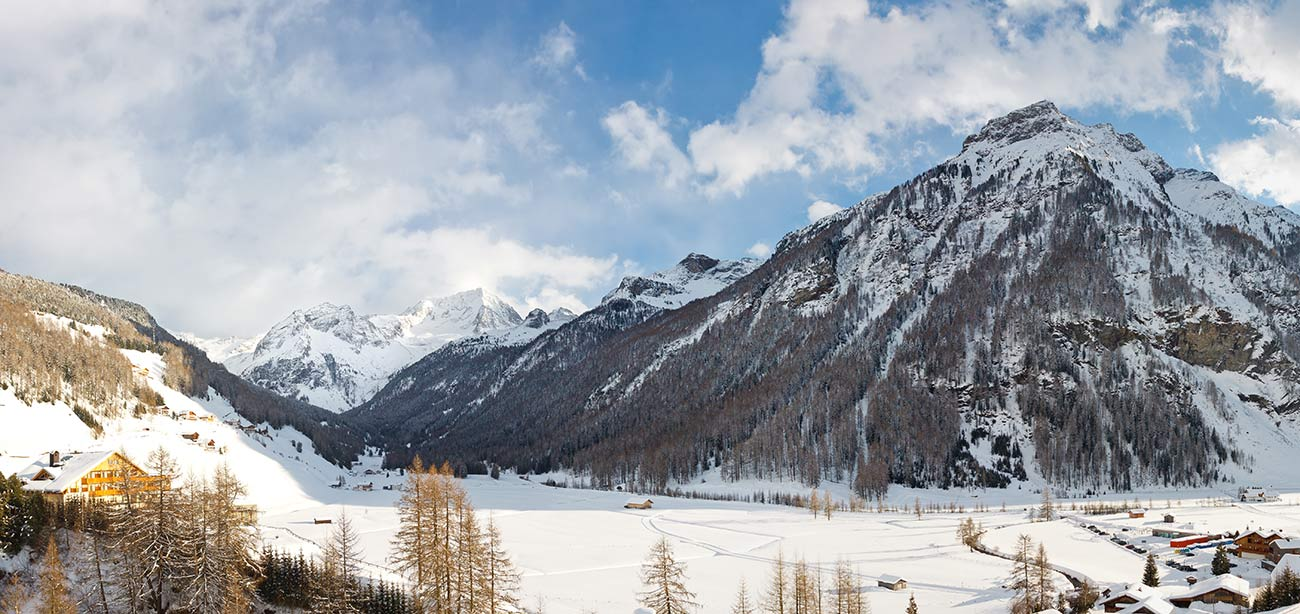 Panoramic views of the snowy mountains of Aurina Valley in South Tyrol