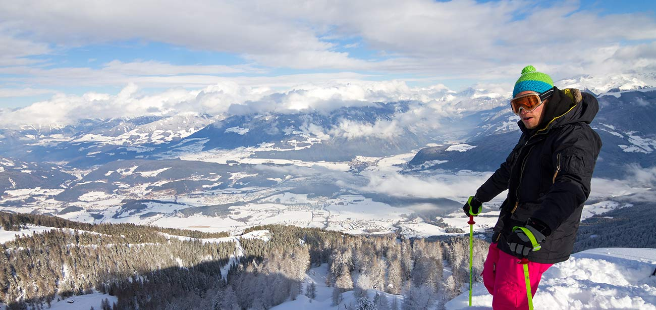 Skier admire the view of the holiday region of Plan de Corones