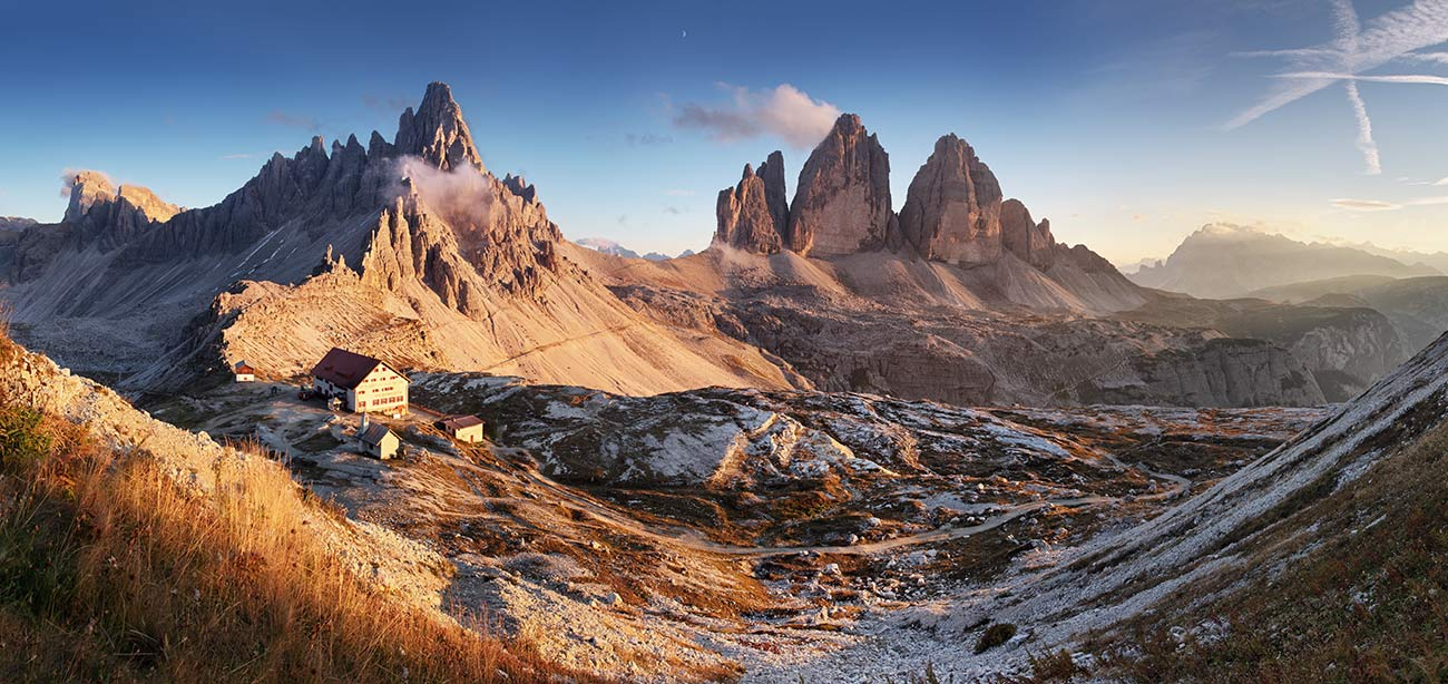 Three Peaks of Lavaredo in the distance with blue sky and twilight