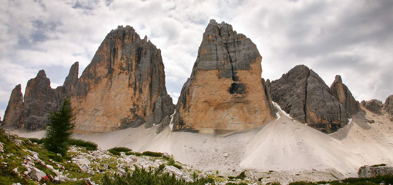 Three Peaks of Lavaredo with dark clouds on the background