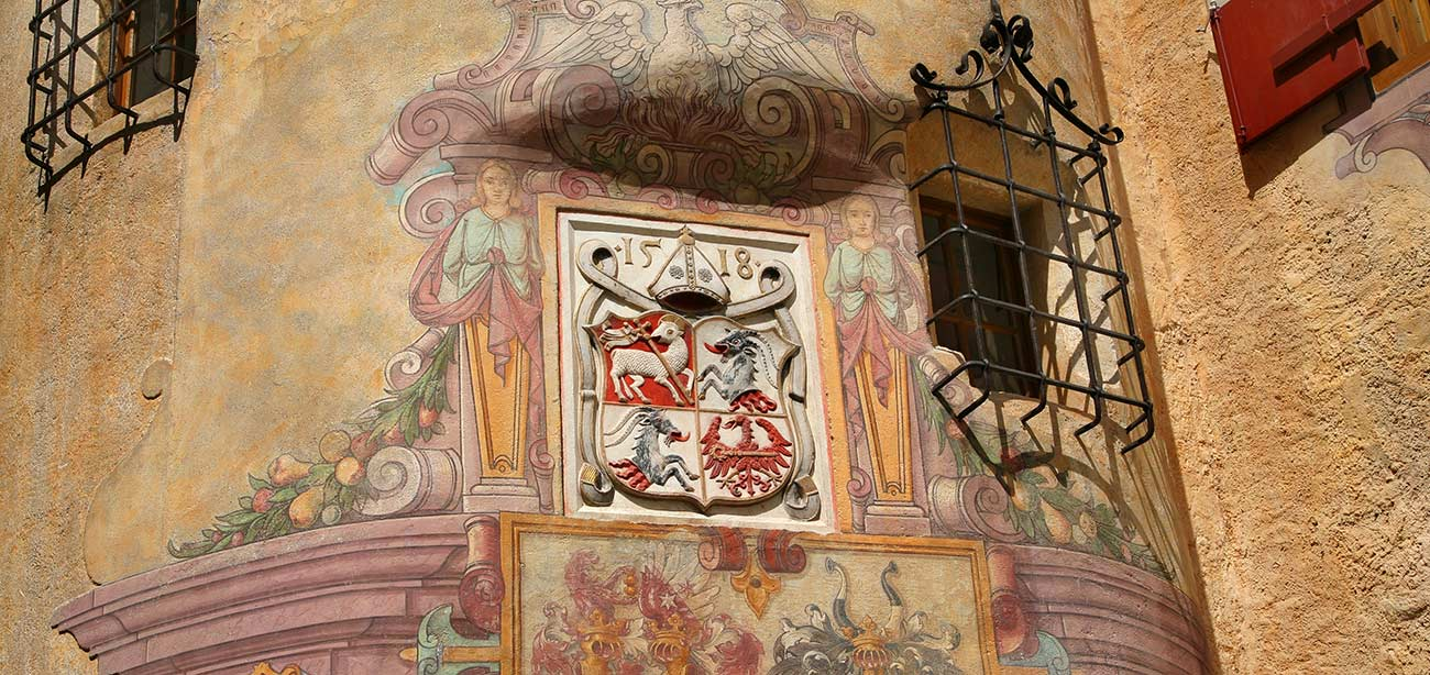 Historic center of Brunico, detail of an ancient house with coat-of-arms