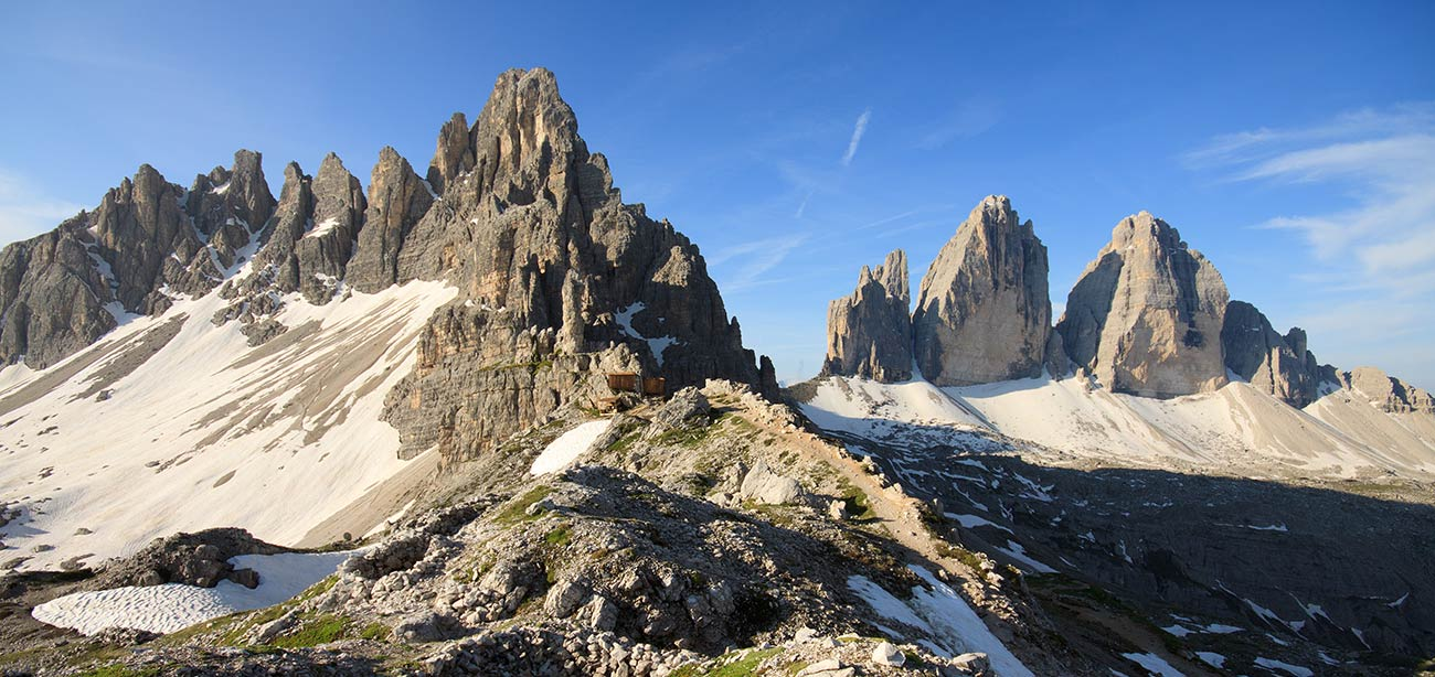 Dolomites with the Three Peaks of Lavaredo and blue sky on the background