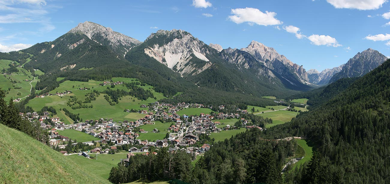 View of the village of San Vigilio di Marebbe with Dolomites on the background
